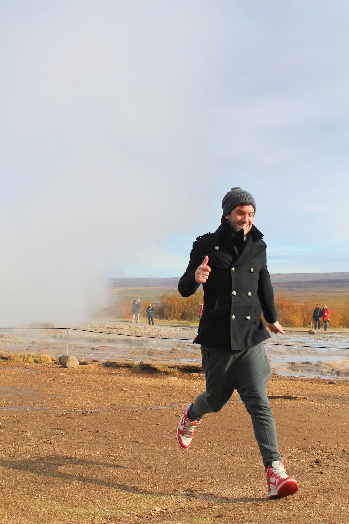 Lloyd Running Away From Geyser in Geysir, Iceland